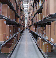 Special forklift at the end of an aisle of freight stacked high.