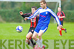 Shanakill Athletic's Shane O'Dowd get to the ball before AC Athletic's Joesph Diggins at Mounthawk park, Tralee on Sunday.