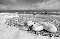 "Ice slush forms small ""ice bergs"" and piles of ice slush that float and smash into the Lake Michigan shore and ice piles."