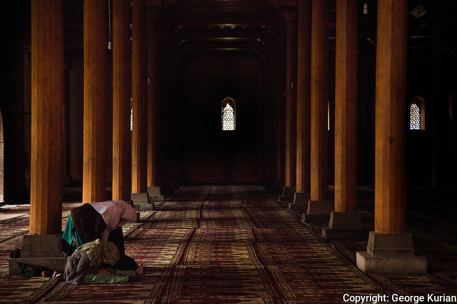 Women have always been allowed in Kashmiri mosques, something alien to many other Islamic cultures.  Women at different stages of performing Salah, in one of the oldest mosques of Kashmir.