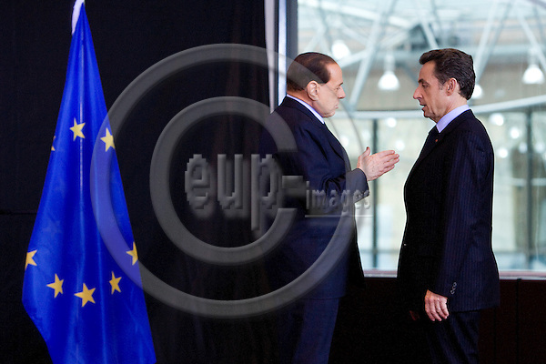 BRUSSELS - BELGIUM - 01 MARCH 2009 --  The Italian Prime Minister Silvio BERLUSCONI (Le) and the French President Nikolas SARKOZY having a private talk during the Emergency meeting on the financial crisis held for European Union leaders.  Photo: Erik Luntang/EUP-IMAGES