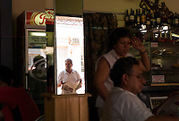 A lunch crowd fills a small restaurant in San Ignacio Guazu, Paraguay, the site of the oldest of scores of Jesuit missions in the area where Paraguay, Argentina and Brazil meet. The missions were built in the 17th century and abandoned when the Jesuits were expelled in the 18th century. Ruins of some of these missions still haunt hilltops in the region. (Kevin Moloney for the New York Times)