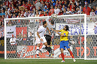 Colombia (COL) goalkeeper Faryd Mondragon (22) grabs a pass intended for Clint Dempsey (8) of the United States (USA). The men's national teams of the United States (USA) and Colombia (COL) played to a 0-0 tie during an international friendly at PPL Park in Chester, PA, on October 12, 2010.