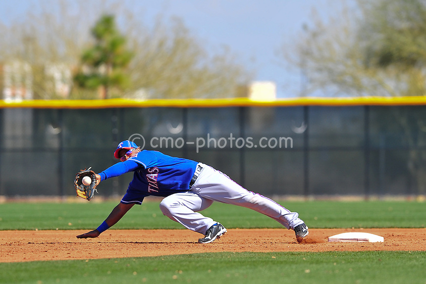 Feb 24, 2011; Surprise, AZ, USA; Texas Rangers shortstop Andres Blanco dives for an errant throw to second base during a stolen base attempt in an intra-squad game played by the Rangers at the Surprise Recreation Campus.