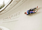 """5 December 2015: Gry Martine Mostue, competing for Norway, slides through Curve 10 """"Shady"""" on her first run of the Viessmann World Cup Women's Luge at the Olympic Sports Track in Lake Placid, New York, USA. Mandatory Credit: Ed Wolfstein Photo *** RAW (NEF) Image File Available ***"""