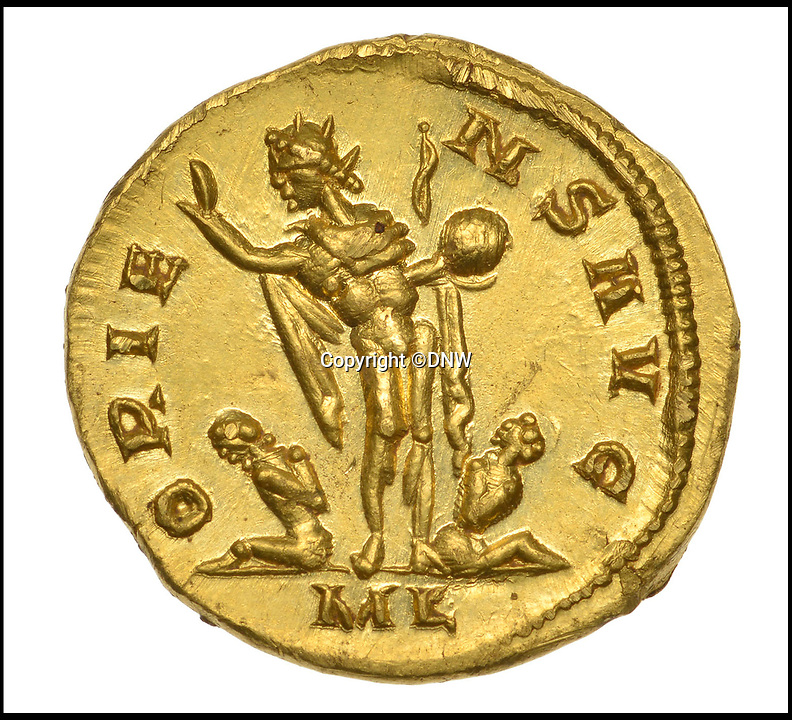 BNPS.co.uk (01202 558833)<br /> Pic: DNW/BNPS<br /> <br /> The reverse has a victorious Roman with two bound captives.<br /> <br /> A lucky metal detectorist has struck gold after a rare Roman coin he discovered sold at auction for more than £550,000.<br /> <br /> The incredibly rare gold coin was found by the unnamed treasure hunter as he searched a newly-ploughed field next to an old Roman road near Dover, Kent.<br /> <br /> The 30-year-old finder thought the coin was fake at first as it was in such good condition. He realised it was genuine when he weighed it at hefty 4.31 grams.
