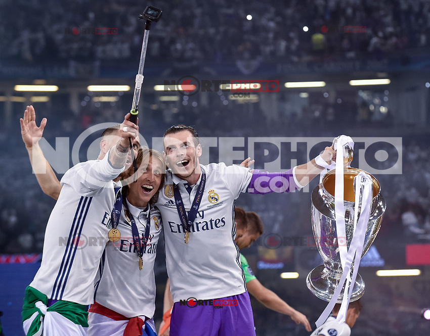 Gareth Bale of Real Madrid, Sergio Ramos of Real Madrid and Luka Modric of Real Madrid celebrate the winning of the Champions League during the UEFA Champions League Final match between Real Madrid and Juventus at the National Stadium of Wales, Cardiff, Wales on 3 June 2017. Photo by Giuseppe Maffia.<br /> <br /> Giuseppe Maffia/UK Sports Pics Ltd/Alterphotos /nortephoto.com