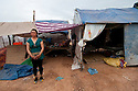 PHNOM PENH, CAMBODIA-- Luy Sinath, who sells used clothing to make ends meet, was displaced from her home a year earlier was forcibly moved on December 15 to a new relocation site at the base of Udon Mountain.  PHOTO BY JODI HILTON