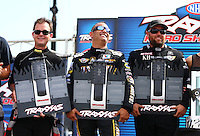 Aug. 31, 2013; Clermont, IN, USA: NHRA top fuel dragster driver Steve Torrence (left) with Tony Schumacher (center) and Shawn Langdon at the Traxxas Shootout during qualifying for the US Nationals at Lucas Oil Raceway. Mandatory Credit: Mark J. Rebilas-