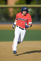 Ayden Karraker (9) of the Liberty Flames hustles towards third base against the Wake Forest Demon Deacons at David F. Couch Ballpark on April 25, 2018 in  Winston-Salem, North Carolina.  The Demon Deacons defeated the Flames 8-7.  (Brian Westerholt/Four Seam Images)