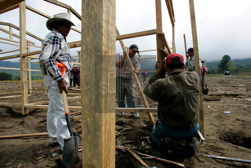 Residents and other workers construct buildings to house residents displaced by mudslides that occured earlier in the month when torrential rains associated with Hurricane Stan inundated parts of Central America. About 25 homes and several fields of crops  in Tzamchaj were lost in the mudslide. The workers will build enough housing and common work, cooking and cleaning areas for 300 families.<br />