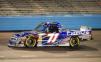Nov. 13, 2009; Avondale, AZ, USA; NASCAR Camping World Truck Series driver Kevin Conway during the Lucas Oil 150 at Phoenix International Raceway. Mandatory Credit: Mark J. Rebilas-