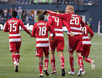Dallas FC forward Brek Shea, second from right, celebrates a goal with teammates Fabian Castillo, Marvin Chavez, Andrew Jacobson Zach Loyd during play at Qwest Field in Seattle Saturday May 14, 2011. Dallas won the game 1-0.