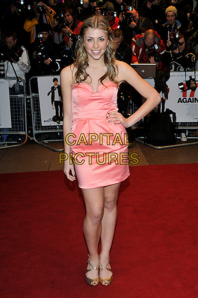 """JEMMA McKENZIE-BROWN .""""17 Again"""" UK film premiere at the Odeon West End cinema, London, England, UK, .26th March 2009..arrivals full length strapless peach coral pink dress hand on hip strapless gold peep toe shoes Gemma Mackenzie Mckenzie Brown .CAP/PL.©Phil Loftus/Capital Pictures"""