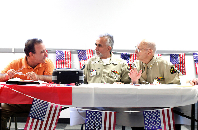 "Oakville, CT- 18, August 2011-0801811CM03  (L-R)   Richard DiFederico, (Navy and served in the Beirut conflict), Richard Hines (U.S. Marines and Vietnam Vet) and Wilfred Cabana (Army and World War II Vet.) share stories during a ham dinner at VFW Post 7330 in Oakville Thursday afternoon. The post put on a ""thank you"" dinner for all war veterans.  Dinner included ham, potatoes, salad and cake.  DiFederico said the VFW needs more young members to join, so that they can fulfill the various patriotic holidays.  Christopher Massa Republican-American"