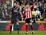 Grant Hanley of Norwich City and Billy Sharp of Sheffield Utd during the Premier League match at Bramall Lane, Sheffield. Picture date: 7th March 2020. Picture credit should read: Simon Bellis/Sportimage
