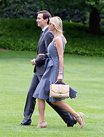 Jared Kushner and Ivanka Trump walk on the South Lawn of the White House to join United States President Donald J. Trump aboard Marine One as they depart the White House in Washington, DC  for a trip to New York City on Thursday, May 4, 2017. Photo Credit: Ron Sachs/CNP/AdMedia