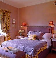 A guest bedroom has been decorated in an exuberant combination of yellow and purple