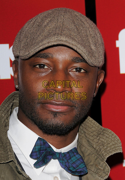 TAYE DIGGS.The 2008 Fuse TV Pre-Grammy Celebration & Concert held at Goa in Hollywood, California, USA..February 7th, 2008                                                                                      .headshot portrait goatee facial hair brown flat cap hat .CAP/DVS.©Debbie VanStory/Capital Pictures