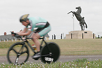 05 MAY 2007 - STETCHWORTH, UK - A Cambridge University competitor races past a statue of a horse and stable lad beside an entrance of Newmarket Racecourse during the BUSA 25 Mile Time Trial Championships. (PHOTO (C) NIGEL FARROW)