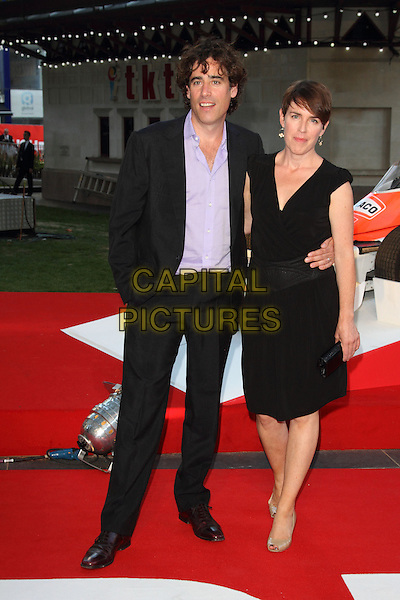 Stephen Mangan &amp; guest<br /> The World Premiere of 'Rush' at the Odeon Leicester Square, London, England.<br /> September 2nd, 2013<br /> full length black suit purple shirt dress<br /> CAP/ROS<br /> &copy;Steve Ross/Capital Pictures