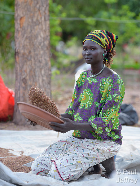 A woman winnows grain at the Loreto Girls Secondary School in Rumbek, South Sudan. The school is run by the Institute for the Blessed Virgin Mary--the Loreto Sisters--of Ireland.