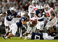 Ohio State Buckeyes running back J.K. Dobbins (2) tries to get past Penn State Nittany Lions linebacker Jan Johnson (36) and Penn State Nittany Lions safety Garrett Taylor (17) on a run in the 2nd quarter of their NCAA football at Beaver Stadium in University Park, Pa. on September 29, 2018.  [Kyle Robertson/Dispatch]