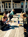 Flunch with a local expert<br /> Alexa Romersa<br /> Undergraduate duke class of 2016, marine lab student<br /> Amr63@duke.edu<br /> Marine lab students enjoying lunch outside on a rare warm, sunny day in Beaufort. Our lunch mate is Captain Pivers, the local pirate and feline master of the island. This photo represents the close knit community at the marine lab and the way students are encouraged to take moments in their day to enjoy life.<br /> TIML