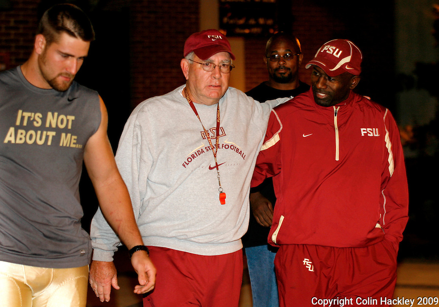 TALLAHASSEE, FL 11/3/09-FSU-ANDREWS RETIRE CH13-Florida State Defensive Coordinator Mickey Andrews, center, leaves the practice field with Graduate Assistant Terrell Buckley, right, and other players after Andrews announced he will retire Feb. 10, 2010, Tuesday during a news conference in Tallahassee. ..COLIN HACKLEY PHOTO