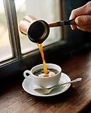 AUSTRIA, Bernstein, a copper craft of coffee is being poured, the Burg Bernstein Castle and Hotel, Burgenland