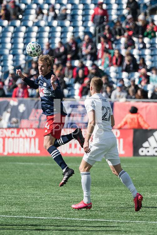 FOXBOROUGH, MA - MARCH 7: Henry Kessler #4 of New England Revolution heads a ball away from Robert Beric #27 of Chicago Fire during a game between Chicago Fire and New England Revolution at Gillette Stadium on March 7, 2020 in Foxborough, Massachusetts.