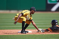 Alabama State Hornets second baseman Oscar Prioleau (9) tags AJ Lee (6) out at second attempting to steal during a game against the Maryland Terrapins on February 19, 2017 at Spectrum Field in Clearwater, Florida.  Maryland defeated Alabama State 9-7.  (Mike Janes/Four Seam Images)