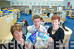 Staff at Castleisland library Lucy Kerins, Eamon Browne and Eileen Murphy who are offering a new book loan service to schools in the area.