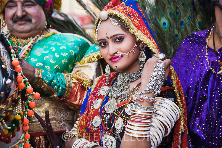 Dressed up people in festivity outfits during a holy procession in Pushkar; Pushkar is one of the five sacred pilgrimage sites for devout Hindus, Pushkar, Rajasthan, India --- Model Released