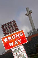 A street sign appears to make a political statement near the controversial Mount Soledad Cross Veterans Memorial in La Jolla California, Sunday, October 21 2007.  A cross has stood on the site since 1913 but in 1989 litigation began to have the cross removed from public land to comply with the first amendment of the United States Constitution separation of church and state.  In 1998 the city of San Diego attempted to resolve the conflict by selling area surrounding the cross was sold to a private group as the first sign explains.  Many residents believed that this was the ?wrong way? to solve the issue.