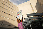 "Leilah Nichols, 8, holds a sign that reads ""Treat Prisoners FairlyÖThe Children Are Watching"" outside the Durham County Jail while attending a protest with her mother, Nadiah Porter, Friday, May 1, 2015. The demonstators were protesting in solidarity with protestors in Baltimore."