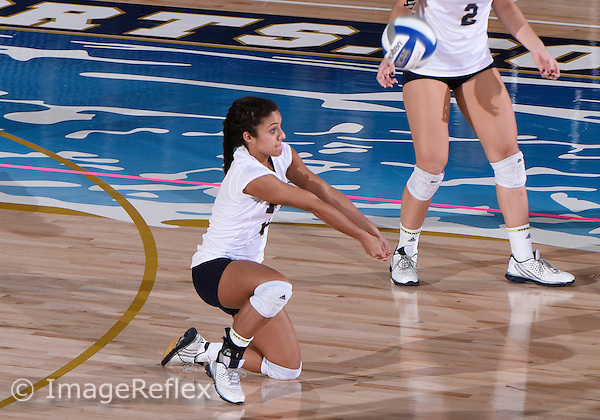 Florida International University women's volleyball libero/defensive specialist Jovanna Santamaria (6) plays against  the University of Central Florida which won the match 3-0 on September 17, 2015 at Miami, Florida.