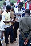 Shoes for sale in a market in Kigali, Rwanda .