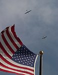 Glider (Sailplane) and towplane flying over an American Flag on a sunny day