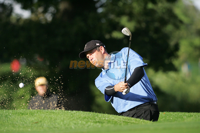 Ryder Cup 206 K Club, Straffin, Ireland...American Ryder cup team player Stewart Cink playing out of the bunker on the 4th during the morning fourballs session of the second day of the 2006 Ryder Cup at the K Club in Straffan, Co Kildare, in the Republic of Ireland, 23 September 2006...Photo: Eoin Clarke/ Newsfile.
