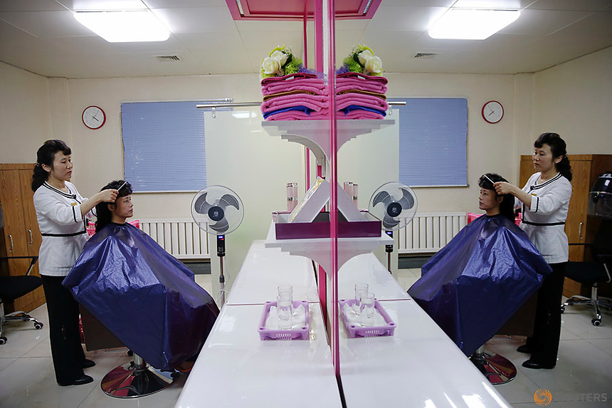A woman is having her hair done during a government organised visit for foreign reporters to the Pyongyang 326 Electric Cable Factory in Pyongyang, North Korea May 6, 2016.  REUTERS/Damir Sagolj