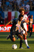 Sheanon Williams (25) of the Philadelphia Union is defended by Nick DeLeon (18) of DC United. DC United defeated Philadelphia Union 1-0 during a Major League Soccer (MLS) match at PPL Park in Chester, PA, on June 16, 2012.
