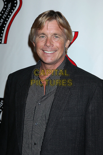 Christopher Atkins<br /> 13th annual Polish film festival at American Cinematheque's Egyptian Theatre, Hollywood, California, USA.<br /> 9th October 2012<br /> headshot portrait black shirt suit jacket stripe<br /> CAP/ADM/RE<br /> &copy;Russ Elliot/AdMedia/Capital Pictures
