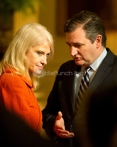 United States Senator Ted Cruz (Republican of Texas), right and Counselor to the President Kellyanne Conway, left, engage in conversation prior to the arrival of US President Donald J. Trump at a reception for US Senators and their spouses in the East Room of the White House in Washington, DC on Tuesday, March 28, 2017.<br /> Credit: Ron Sachs / Pool via CNP /MediaPunch