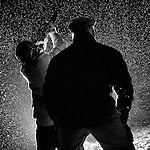 Pix: Shaun Flannery/shaunflanneryphotography.com...COPYRIGHT PICTURE>>SHAUN FLANNERY>01302-570814>>07778315553>>..4th February 2012..A gamekeeper watches over his son as he fires a 20 bore shotgun during a snow storm..An Orange Roan Cocker Spaniel working dog watches on.