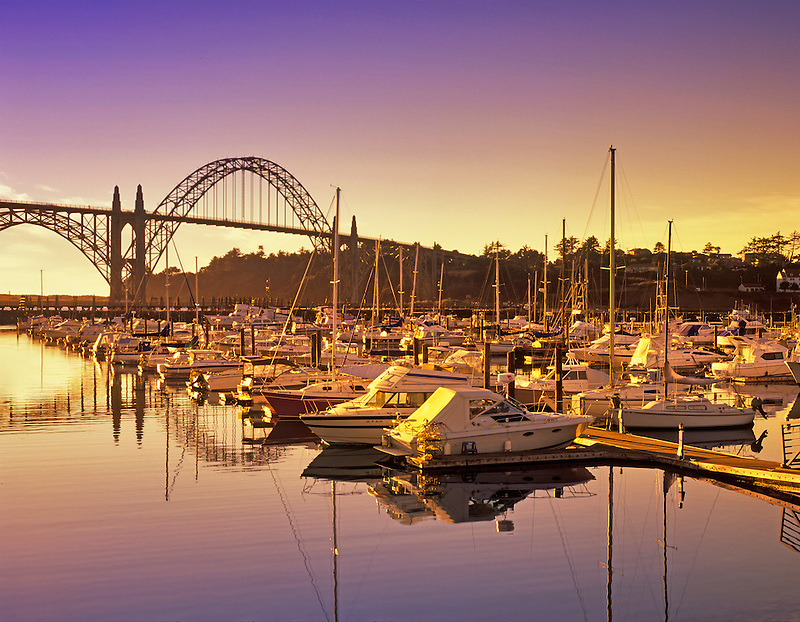Boats in Yaquina Bay with bridge. Newport, Oregon