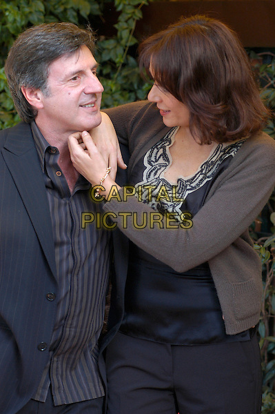 "DANIEL AUTEUIL & VALERIA GOLINO.Photocall for ""36 Quais des Orfevres"" .Hotel Eden, Rome, Italy, 14th January 2005..half length hugging arm around shoulder waist.Ref: LC.www.capitalpictures.com.sales@capitalpictures.com.©Luca Cavallari/Capital Pictures ."
