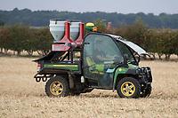 Applying slug pellets to emerging oilseed rape plants <br /> &copy;Tim Scrivener Photographer 07850 303986<br />      ....Covering Agriculture In The UK....