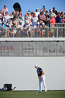 The crowd erupts as Rickie Fowler (USA) sinks his birdie putt on 16 during round 3 of the Honda Classic, PGA National, Palm Beach Gardens, West Palm Beach, Florida, USA. 2/25/2017.<br /> Picture: Golffile | Ken Murray<br /> <br /> <br /> All photo usage must carry mandatory copyright credit (&copy; Golffile | Ken Murray)