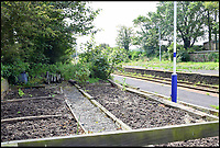 BNPS.co.uk (01202 558833)<br /> Pic: HatchedEstateAgents/BNPS<br /> <br /> Vegetable patch made from old sleepers.<br /> <br /> A commuters dream residence - Cumbrian property comes with request stop train platform out the back.<br /> <br /> Rail buffs should be well chuffed with this dream property - on the market for offers in the region of &pound;215,000.<br /> <br /> Bootle Station in Cumbria, which was once the scene of a dramatic wartime explosion that cost a driver his life, still runs as a request stop on the Cumbrian Coast line from Carlisle to Barrow.<br /> <br /> Trains pass by the property daily, but the station is no longer staffed and the building, which was once the railway waiting rooms, has been converted into a quirky two-bedroom home.<br /> <br /> The house, made of red granite and sandstone, was built in the 1850s and has the original station clock, which still works.
